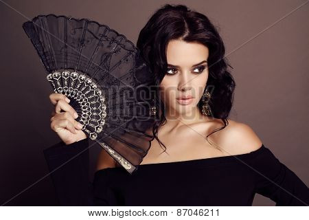 Beautiful Sensual Woman With Dark Hair Holding Black Lace Fan In Hand