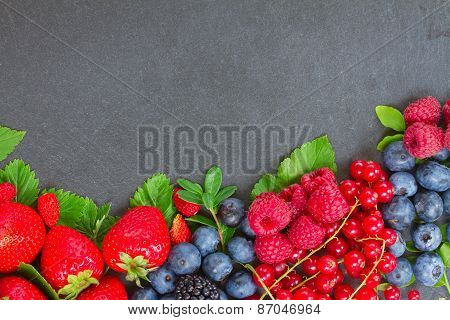 border of fresh berries