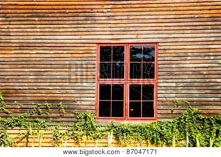 Red Metal Windows On Wood Wall