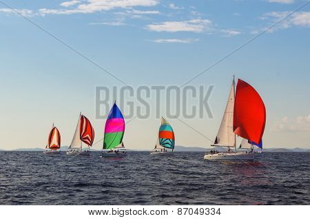 colorful sails under a blue sky