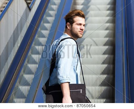 Cool Guy Standing On Escalator