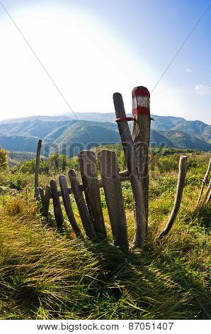 Ruined old wooden fence at sunny autumn afternoon