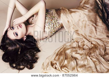 Young Woman With Long Dark Hair Wearing Luxurious Sequin Dress