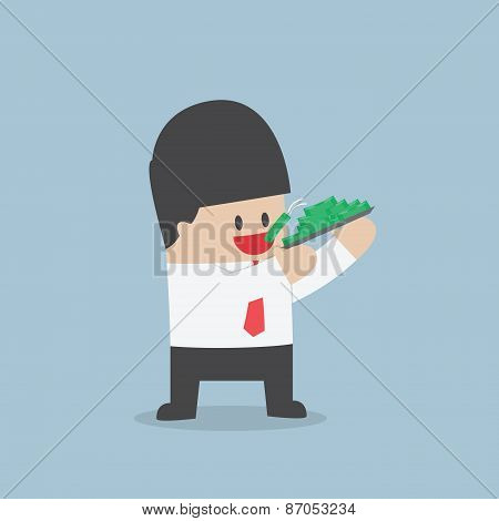 Businessman Eating Dollars, Corruption And Greed Concept