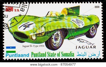 SOMALIA - CIRCA 2010: Postage stamp printed in Somali republic shows retro car,  Jaguar D-Tipe 1954,circa 2010.
