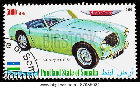 SOMALIA - CIRCA 2010: Postage stamp printed in Somali republic shows retro car,  Austin-Healey 100 1952,circa 2010.