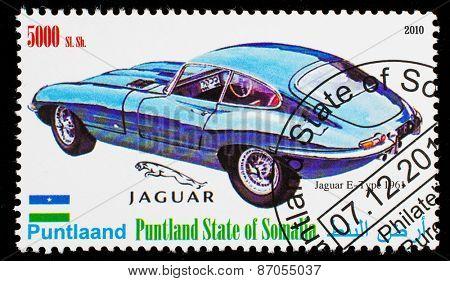 SOMALIA - CIRCA 2010: Postage stamp printed in Somali republic shows retro car, Jaguar E-Tipe 1961,circa 2010.