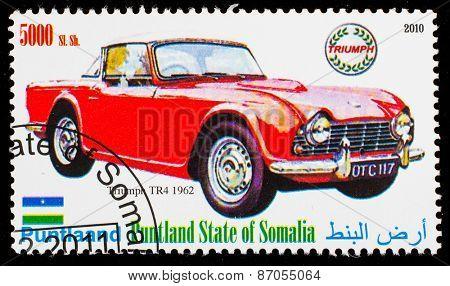 SOMALIA - CIRCA 2010: Postage stamp printed in Somali republic shows retro car,  Triumph TR4 1962,circa 2010.