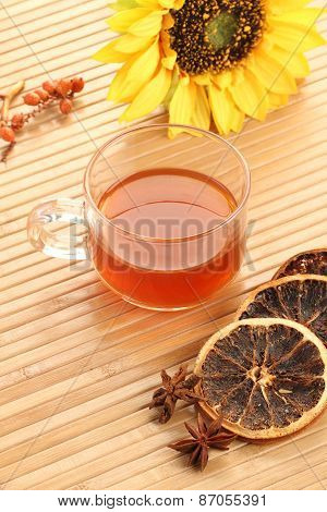 Herbal Tea Cup With Dried Lemon On Wooden Background