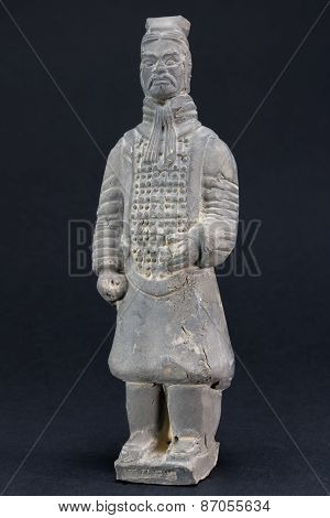 Gray Oriental Man Statuette Over Black Background