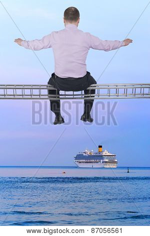 Businessman sitting on light metal girder beam with cruise ship in background