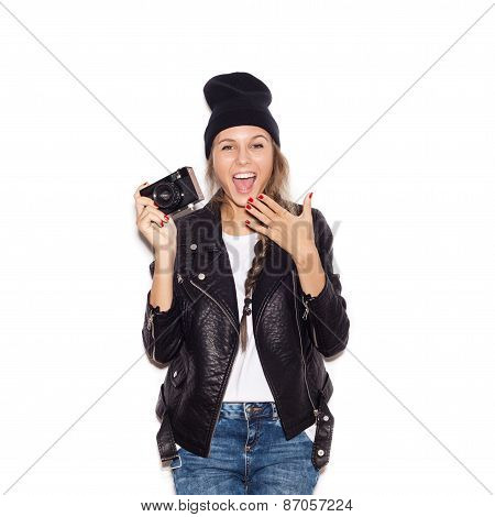 Happy Hipster Girl In Black Beanie Having Fun With Vintage Noname Camera