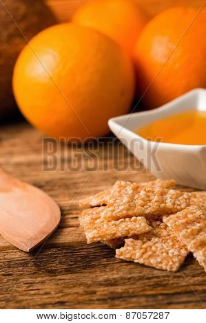 Sesame Seeds In Honey In Front Of Fruit