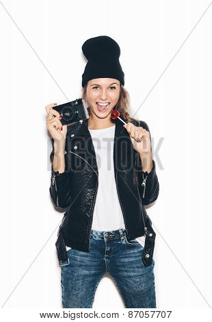 Hipster Girl In Black Beanie Sucking Lollipop Having Fun With  Camera