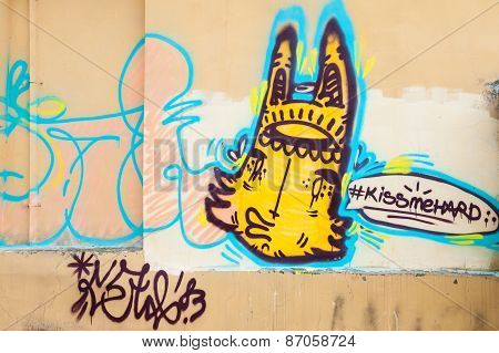Graffiti With Yellow Monster On The Wall