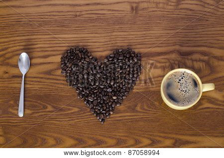 coffee beans, spoon, cup of coffee