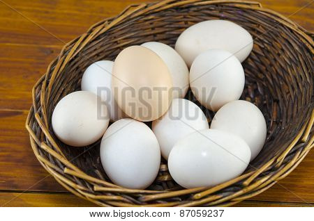 Dozen Of White Eggs In A Wooden Basket