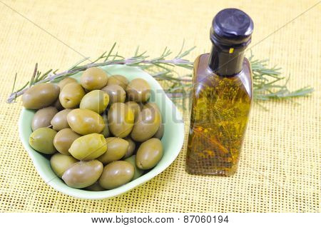 Green Olives And A Bottle Of Virgin Olive Oil