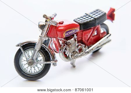 Moscow, Russia - April 04, 2015  - Close-up Of Miniature Red Toy Motorcycle Honda On White Backgroun
