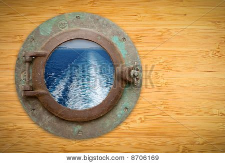 Antique Porthole On Bamboo Wall With View Of Ship Ocean Trail