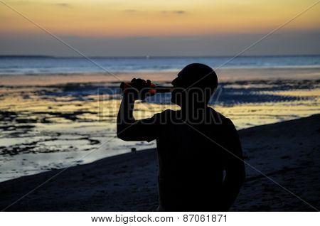 Drinking At Sunset