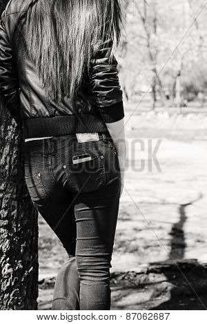 Young Woman Leaning On The Old Big Tree. Black And White