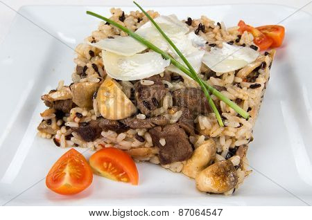 Veal with rice and mushrooms.