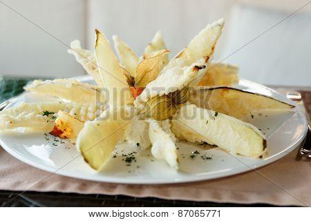 Deep fried eggplant in tempura coating on restaurant table
