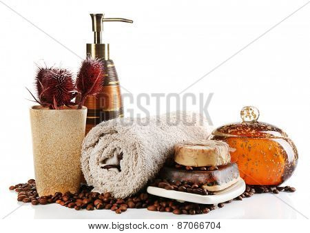 Composition of cosmetic bottle,s soap and towel, isolated on white