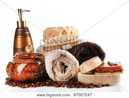 Composition of cosmetic bottles, soap and towel, isolated on white