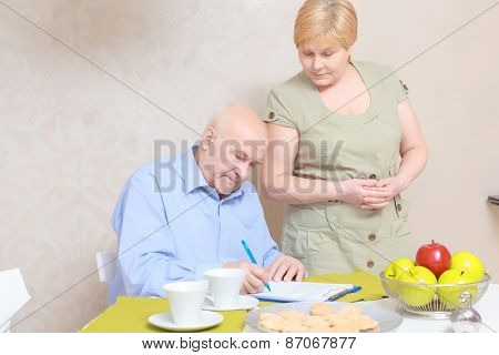 Couple works with documents