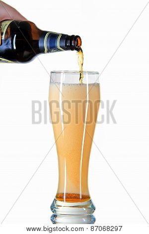 beer from  bottle poured into a glass