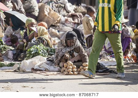 ADDIS ABABA, ETHIOPIA-October 31, 2014 Unidentified women and children sell vegetables at an outdoor market in Addis Ababa, Ethiopia