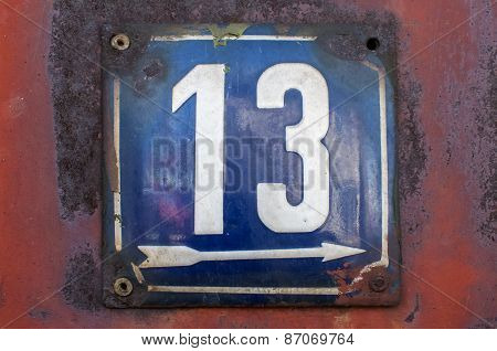 Weathered enameled plate number 13