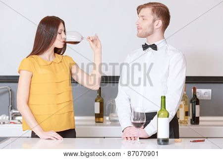 Woman tastes red wine