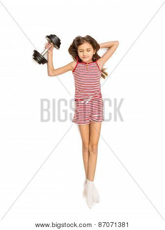 Isolated Shot Of Little Girl Lifting Heavy Dumbbell