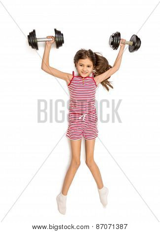 Isolated Shot Of Cute Smiling Girl Lifting Up Two Bug Dumbbells