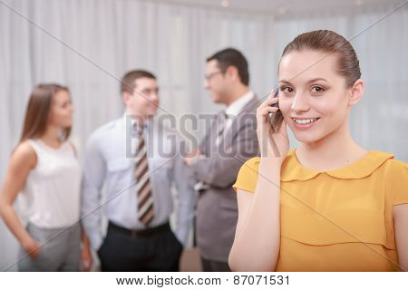 Female business manager managing calls