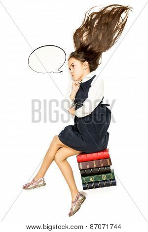 Isolated Shot Of Thoughtful Schoolgirl Sitting On Pile Of Book