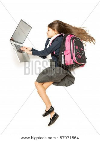 Top View Isolated Shot Of Schoolgirl With Backpack Using Laptop