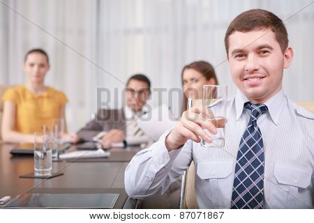 Businessman shows thumbs up