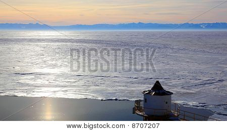 Frozen Lake Baikal. Sunset.