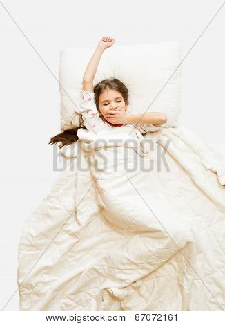 Isolated Shot Of Little Girl Yawning In Bed At Morning
