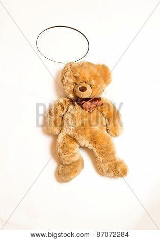 Cute Teddy Bear With Copyspace Speech Bubble Lying On Floor