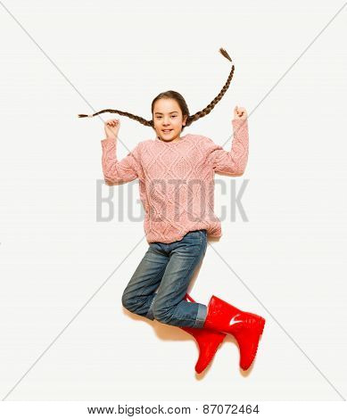 Isolated Photo From Top Of Happy Jumping Girl In Red Rubber Boots