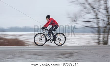 Woman riding her bike. Panning