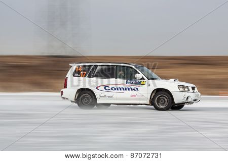 White subaru Forester on ice track