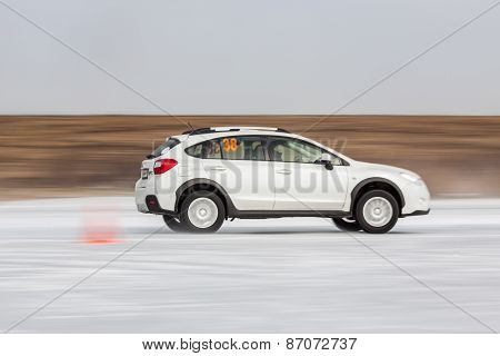 White subaru Impreza XV on ice track