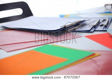 Worktable covered with documents