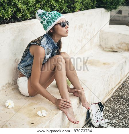 Fashion Young Woman In Sunglasses And Denim Vest Relaxing On A Sunny Day